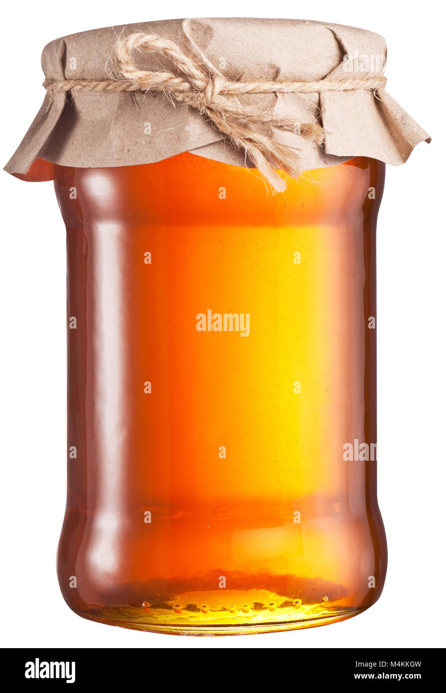 Jar full of fresh honey. File contains clipping path. - Stock Image