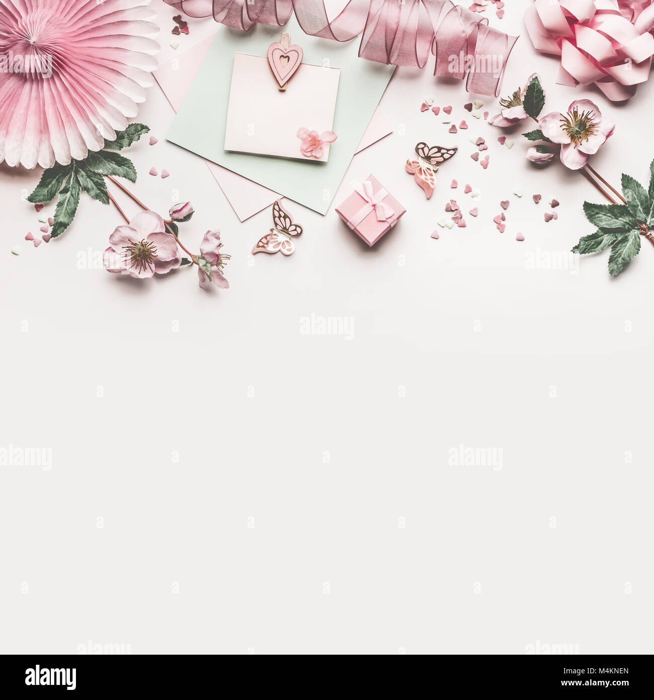 Beautiful pastel pink work space with flowers decorationribbon beautiful pastel pink work space with flowers decorationribbon hearts bow and card mock up on white desk background top view flat lay border we izmirmasajfo