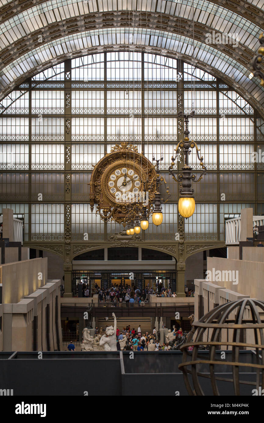 PARIS -SEPTEMBER 7, 2014: Golden clock of the museum D'Orsay in Paris, France. Musee d'Orsay has the largest - Stock Image