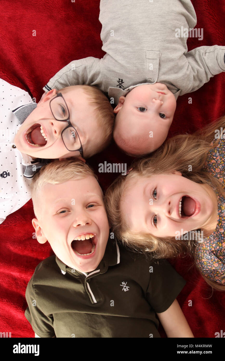family life,four siblings happy and playing together, Big family - Stock Image