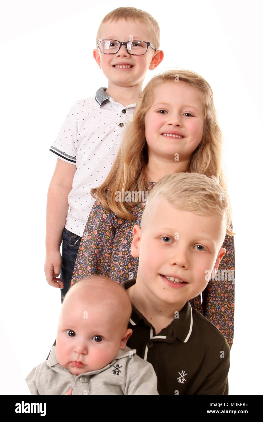 family life,four siblings happy and playing together, Big family Stock Photo