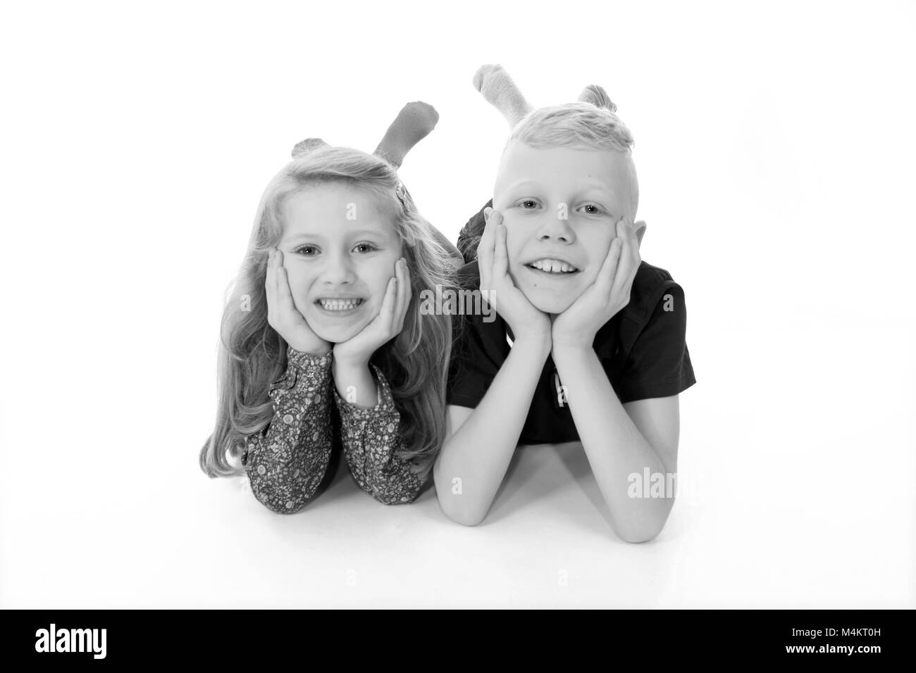 brother and sister, laughing and having fun, happy childhood - Stock Image
