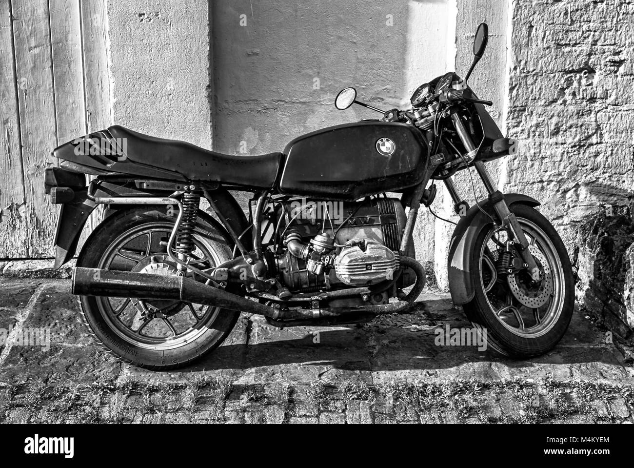 Old BMW motorcycle parked on its stand. - Stock Image