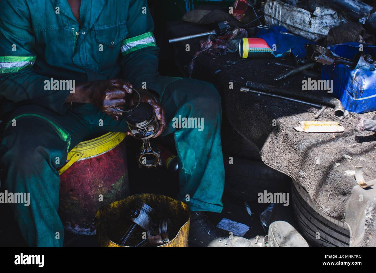 Mechanic repairing auto parts - Stock Image