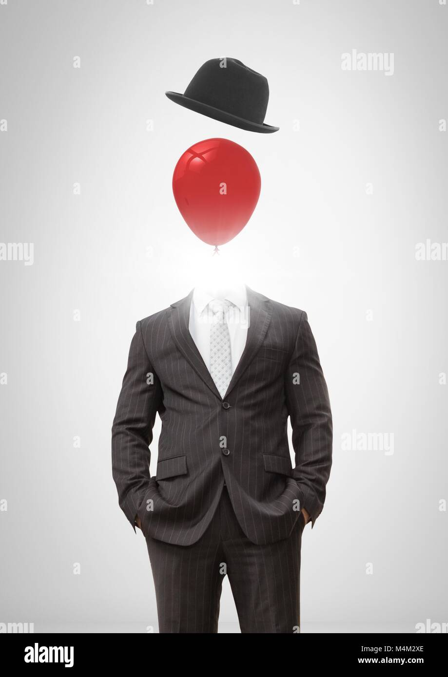 Headless man with surreal floating hat and balloon - Stock Image