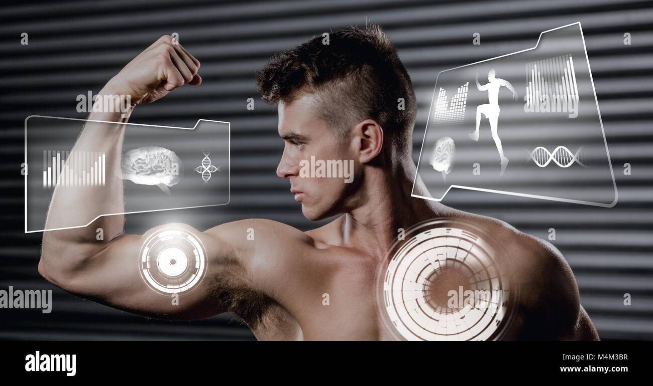 Athletic fit man flexing muscles in gym with health interface - Stock Image
