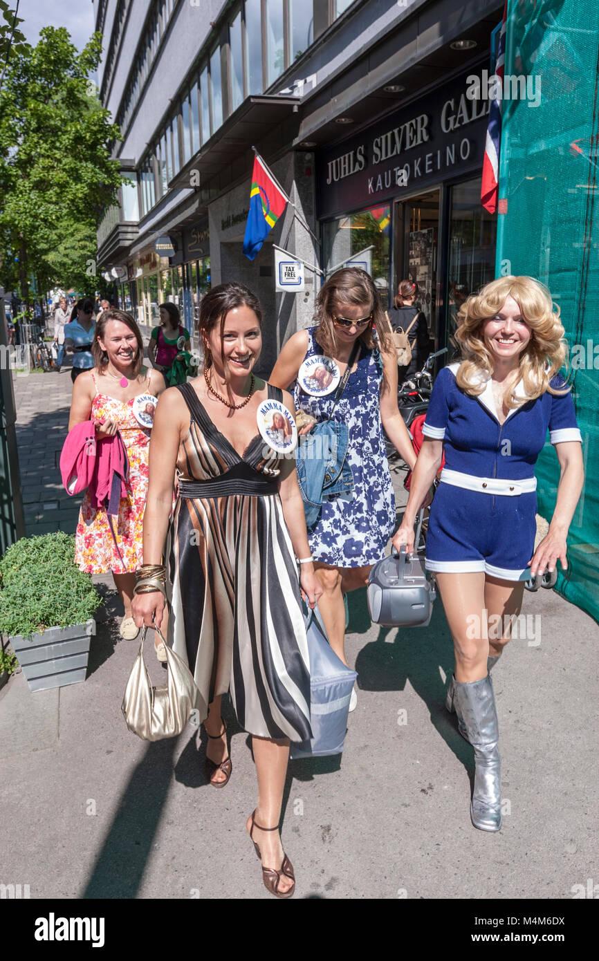 Four Norwegian girls with ABBA custom in a Oslo street