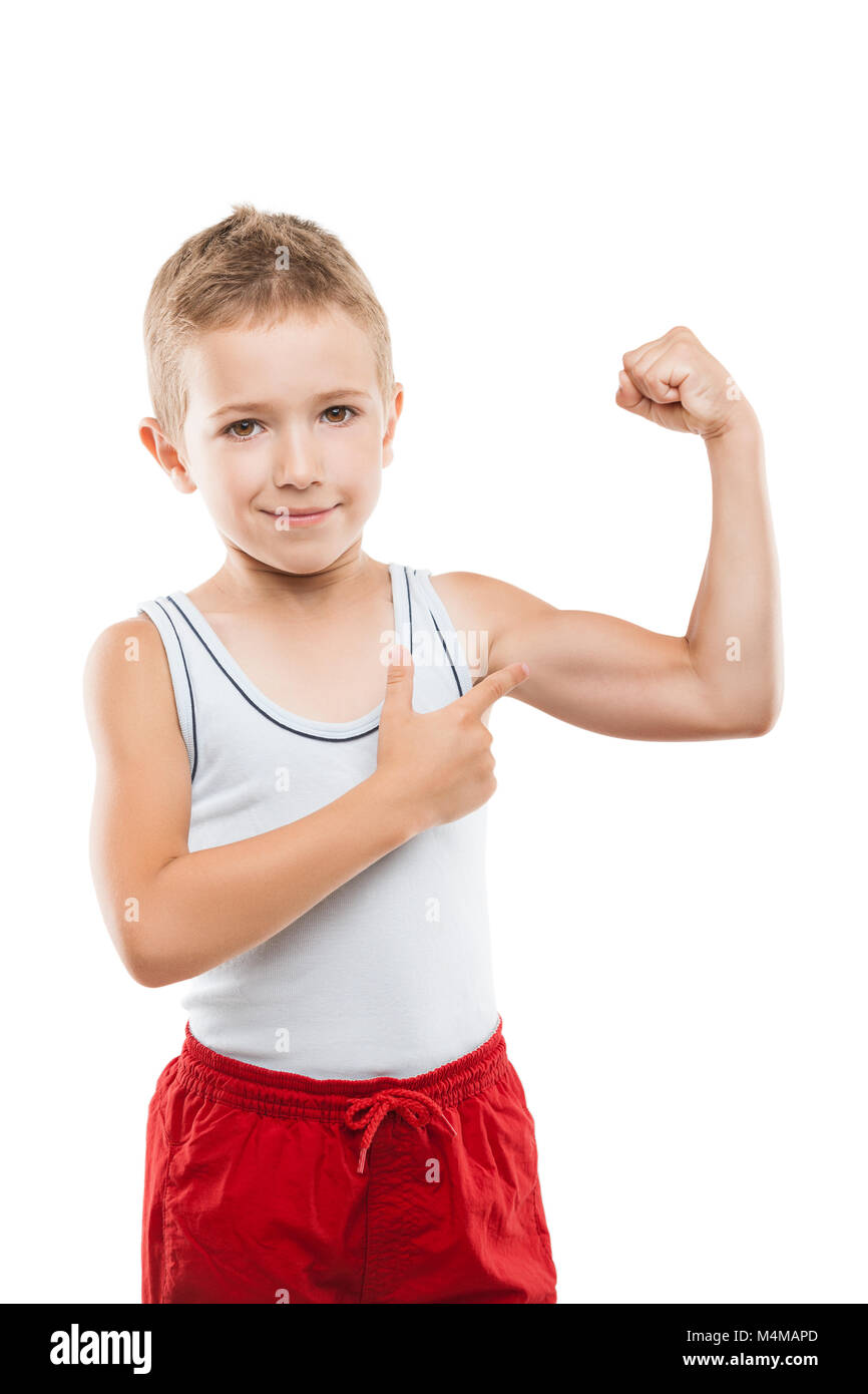 Smiling sport child boy showing hand biceps muscles strength - Stock Image