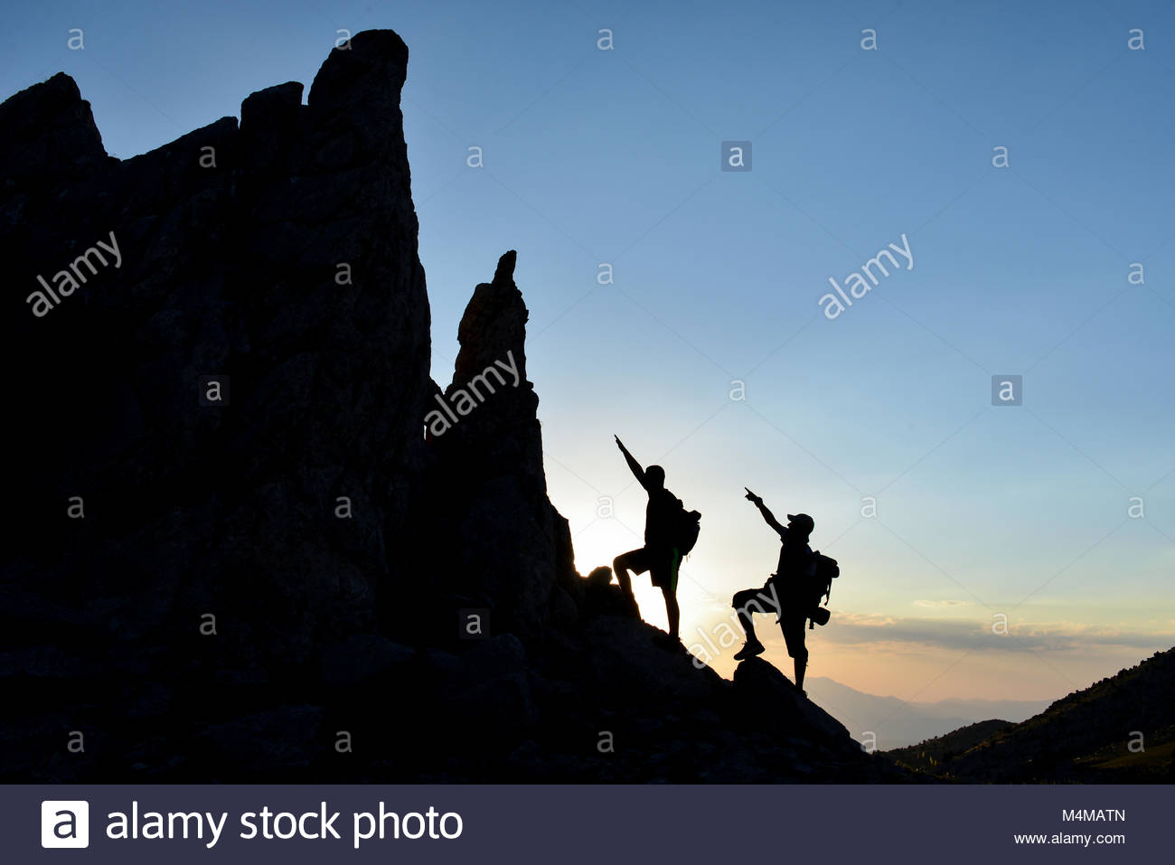 climbers accessing pointy rocks - Stock Image
