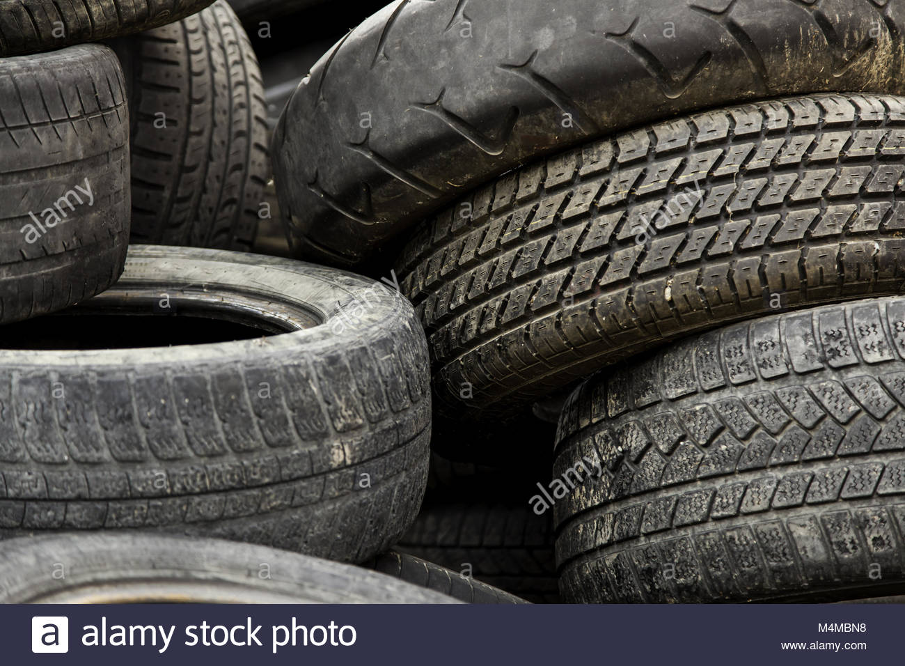 Old car tires in a landfill - Stock Image