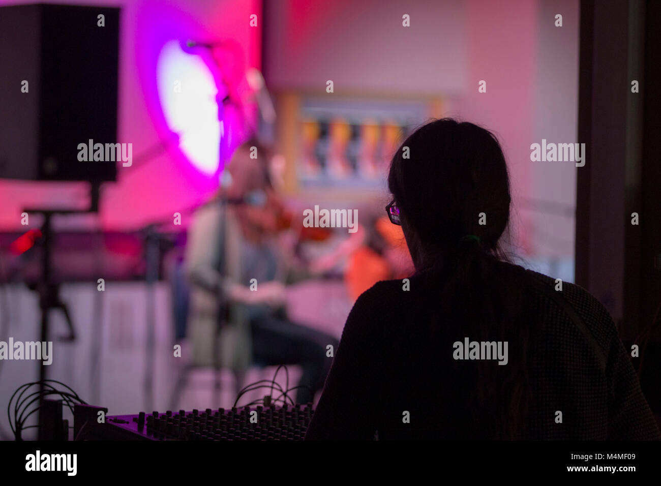 recording technicians at mixing desk during concert Stock Photo