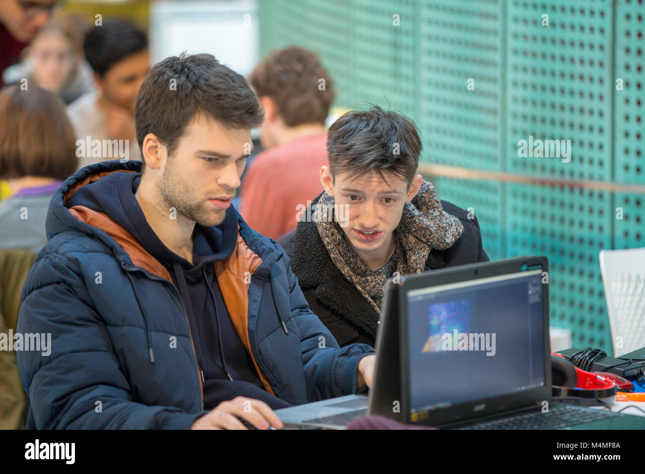 students and young adults studying and socialising - Stock Image