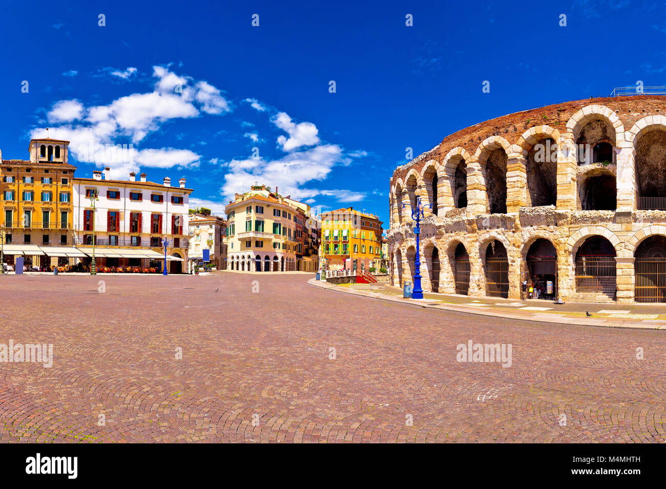 Roman amphitheatre Arena di Verona and Piazza Bra square panoramic view, landmark in Veneto region of Italy - Stock Image