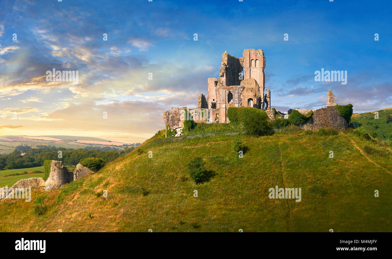 Medieval Corfe castle keep & battlements at sunrise, built in 1086 by William the Conqueror, Dorset England - Stock Image