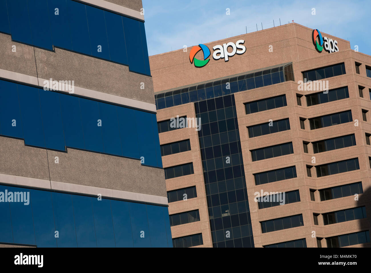 A logo sign outside of the headquarters of Arizona Public Service (APS) in Phoenix, Arizona, on January 30, 2018. Stock Photo