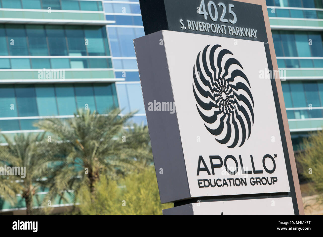 A logo sign outside of the headquarters of the Apollo Education Group, Inc., parent company of the for-profit college, - Stock Image