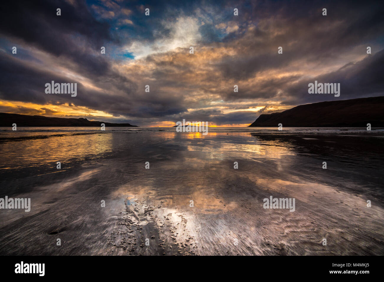 Sunset over Canna from Glen Brittle Beach - Stock Image