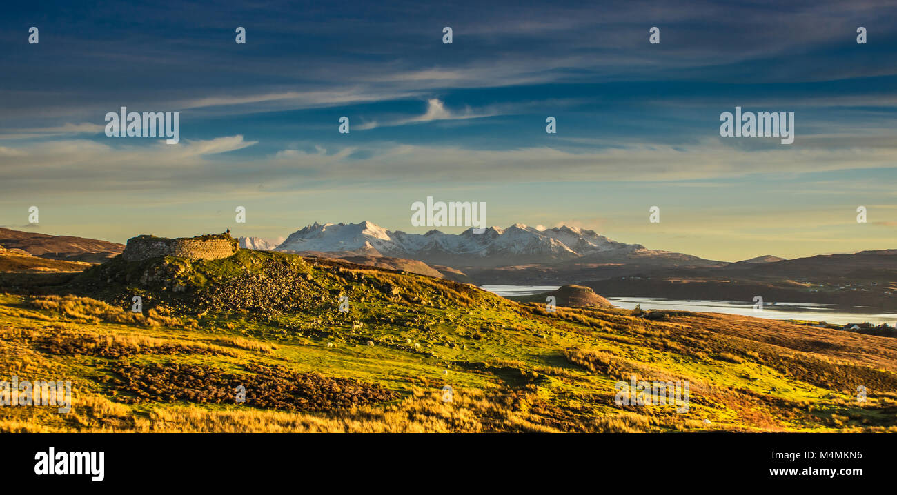 Dun Beag Broch with the Cuillin ridgein the background. - Stock Image
