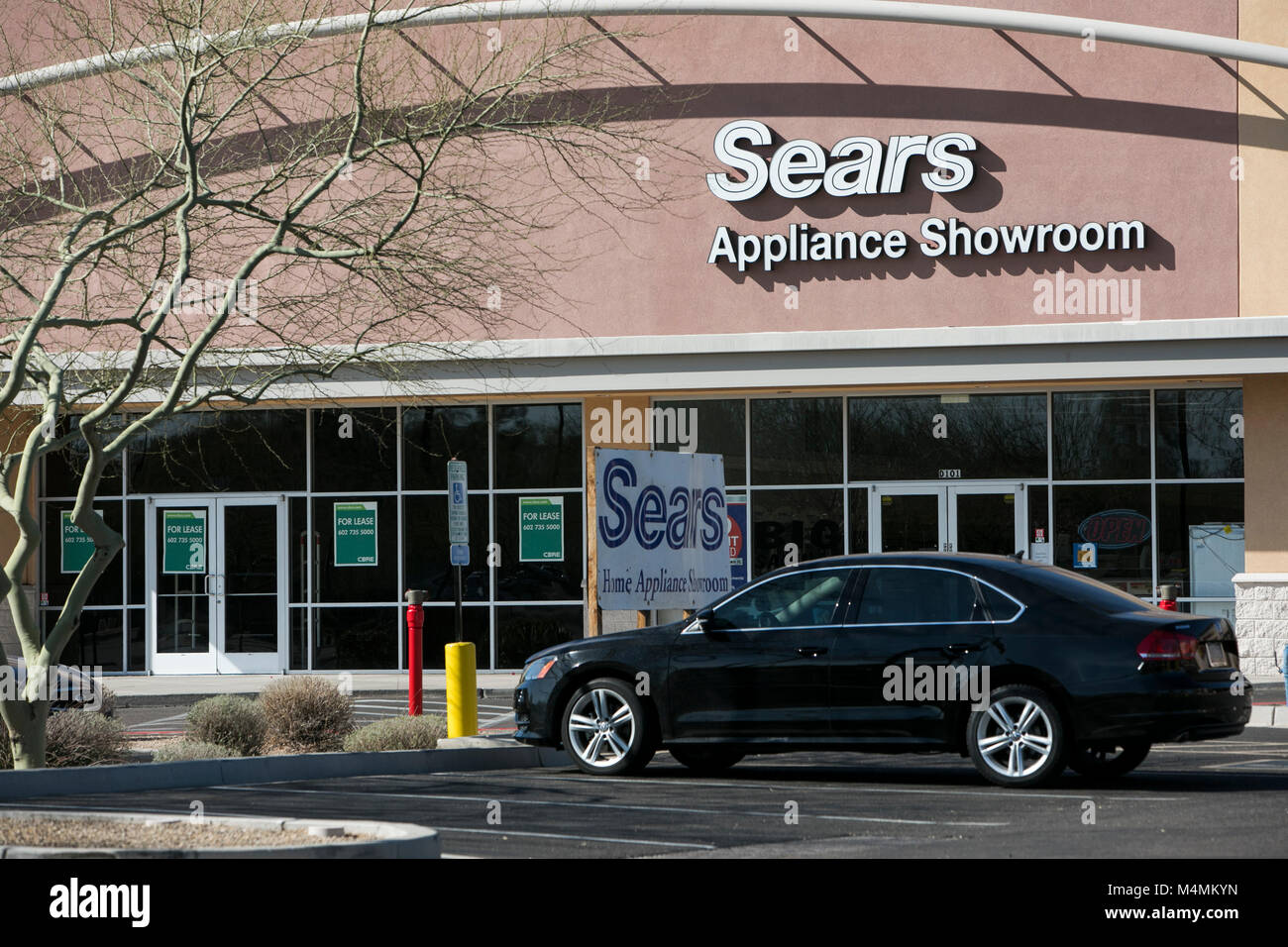 A logo sign outside of a Sears Appliance Showroom in Scottsdale, Arizona, on February 4, 2018. - Stock Image