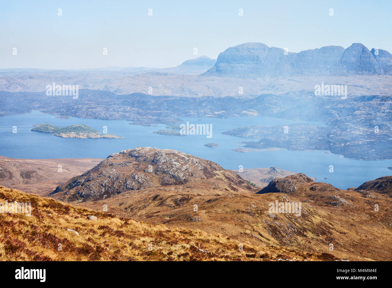 Unearthly mountain landscape.  Loch Sionascaig and Suilven in spring ( View from Stac Pollaidh  towards Suilven), - Stock Image