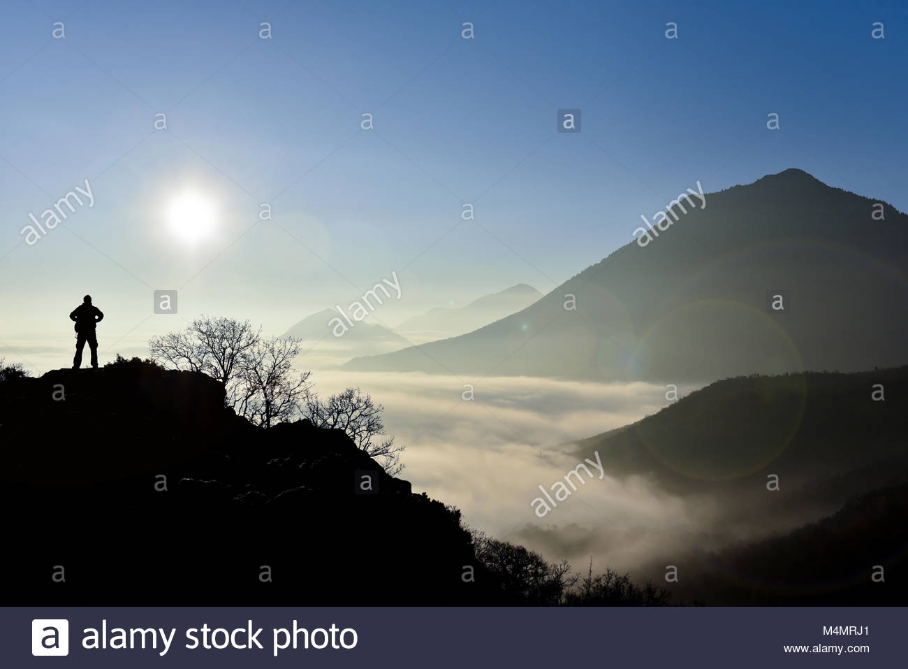 Sunrising in foggy weather - Stock Image