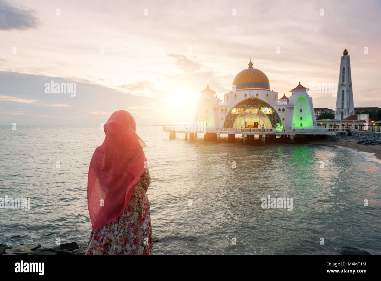 Malacca Straits Mosque with Muslim pray in Malaysia. Malaysian muslim with mosque religion concept. - Stock Image