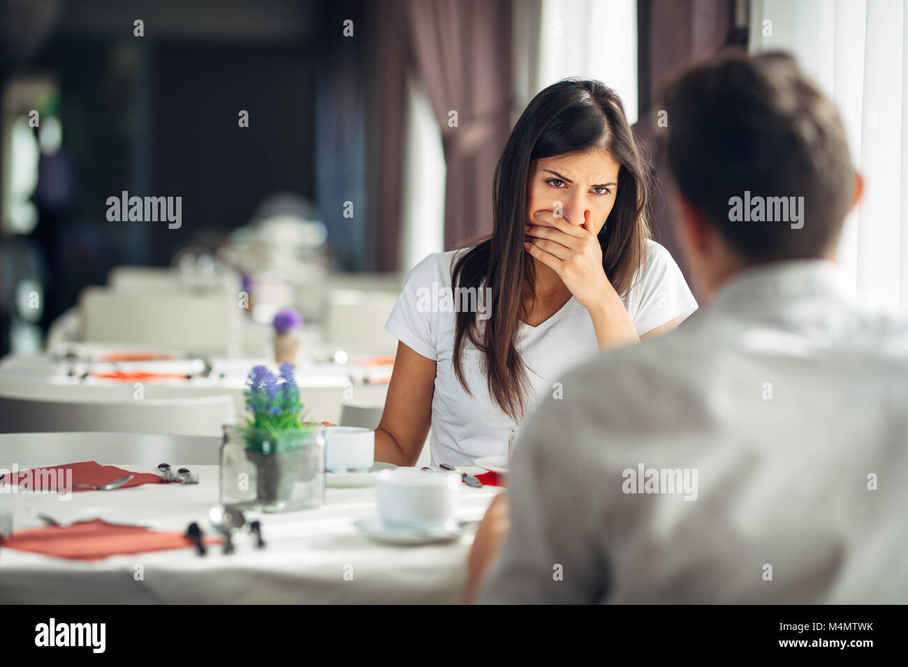Shocked woman in disbelief.Handling bad news.Relationship,marital problems.Woman hearing confession from husband.Disappointed - Stock Image