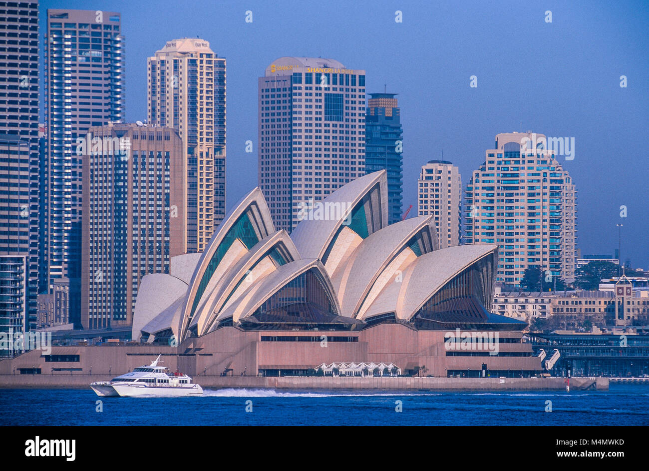 Sydney Opera House is situated at Bennelong Point on the shores of Sydney Harbour in Australia. It was designed - Stock Image
