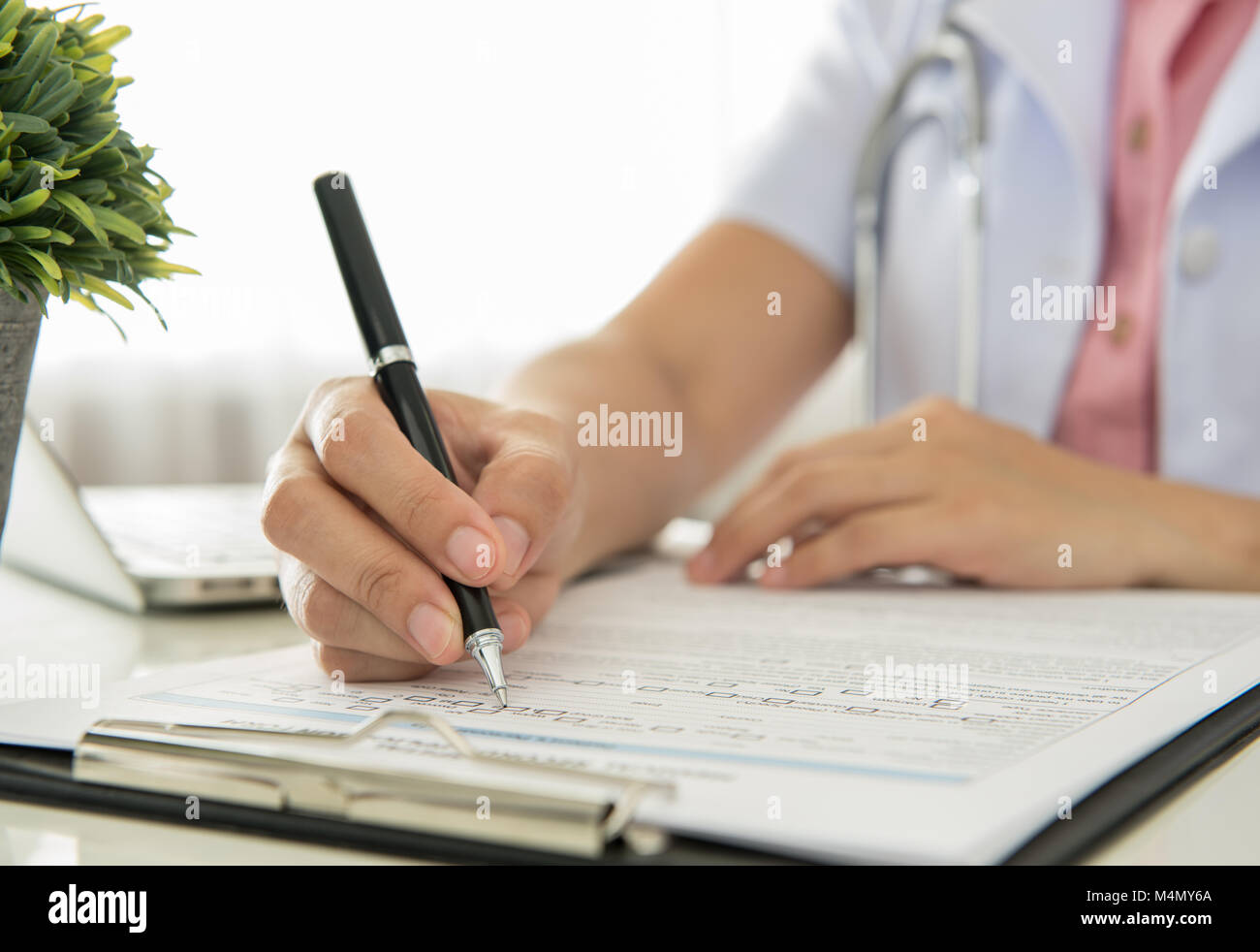 Doctors are recorded patient data for analysis. - Stock Image
