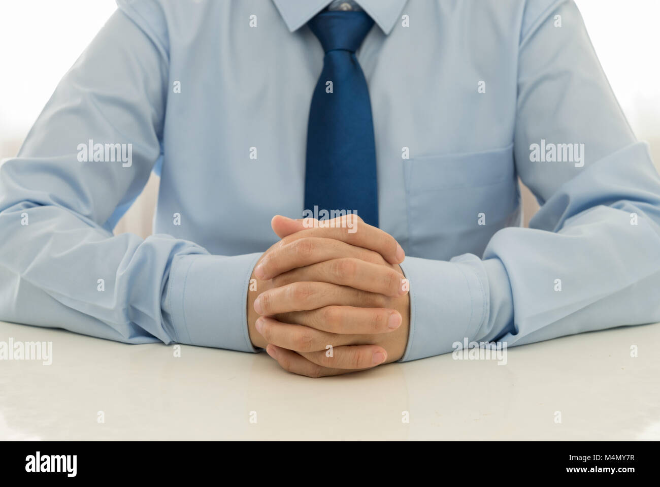 Employees are listening to suggestions or complaints from customers. - Stock Image