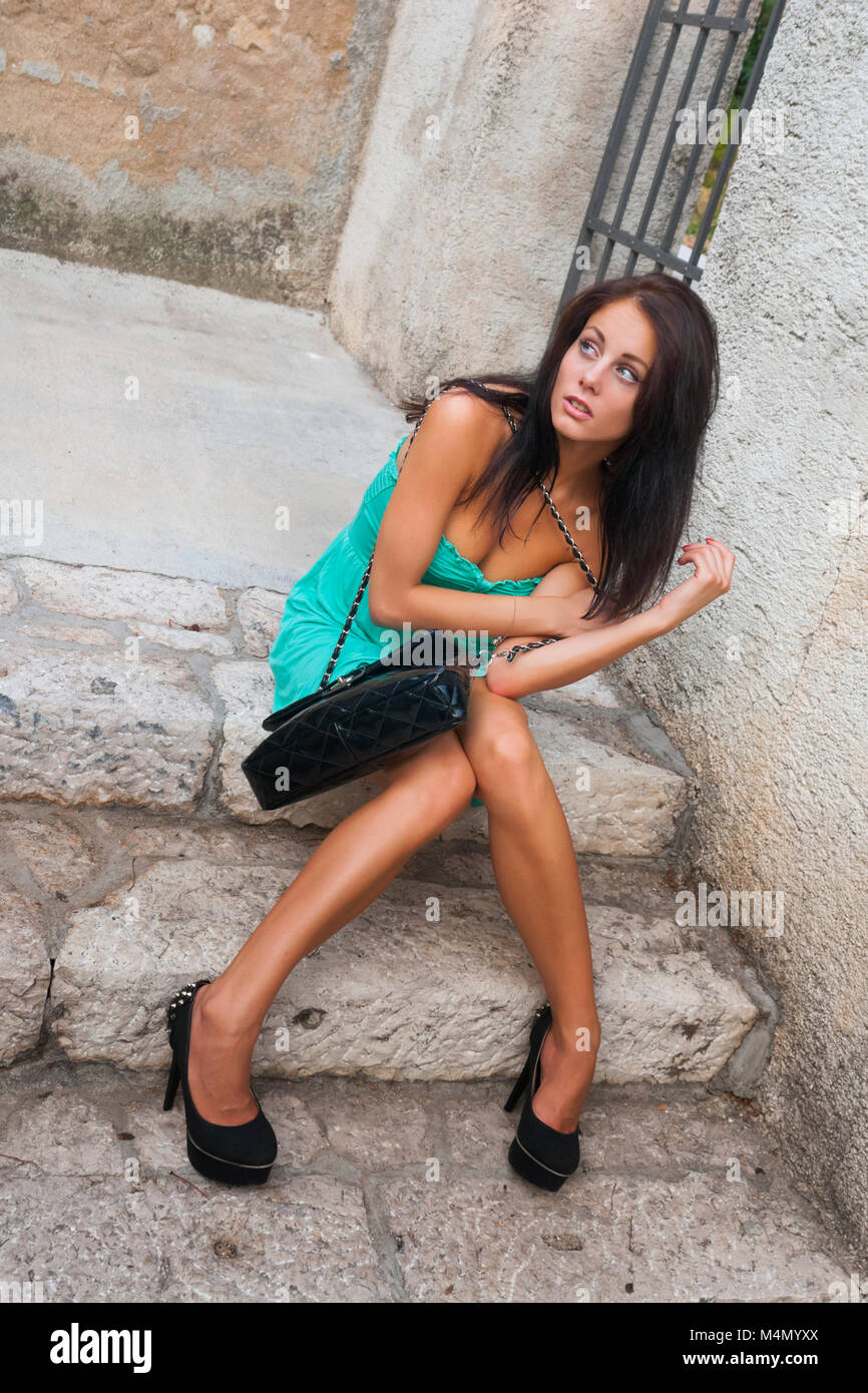 Young woman legs heels pumps stiletto shoes wellbeing human being Stock Photo