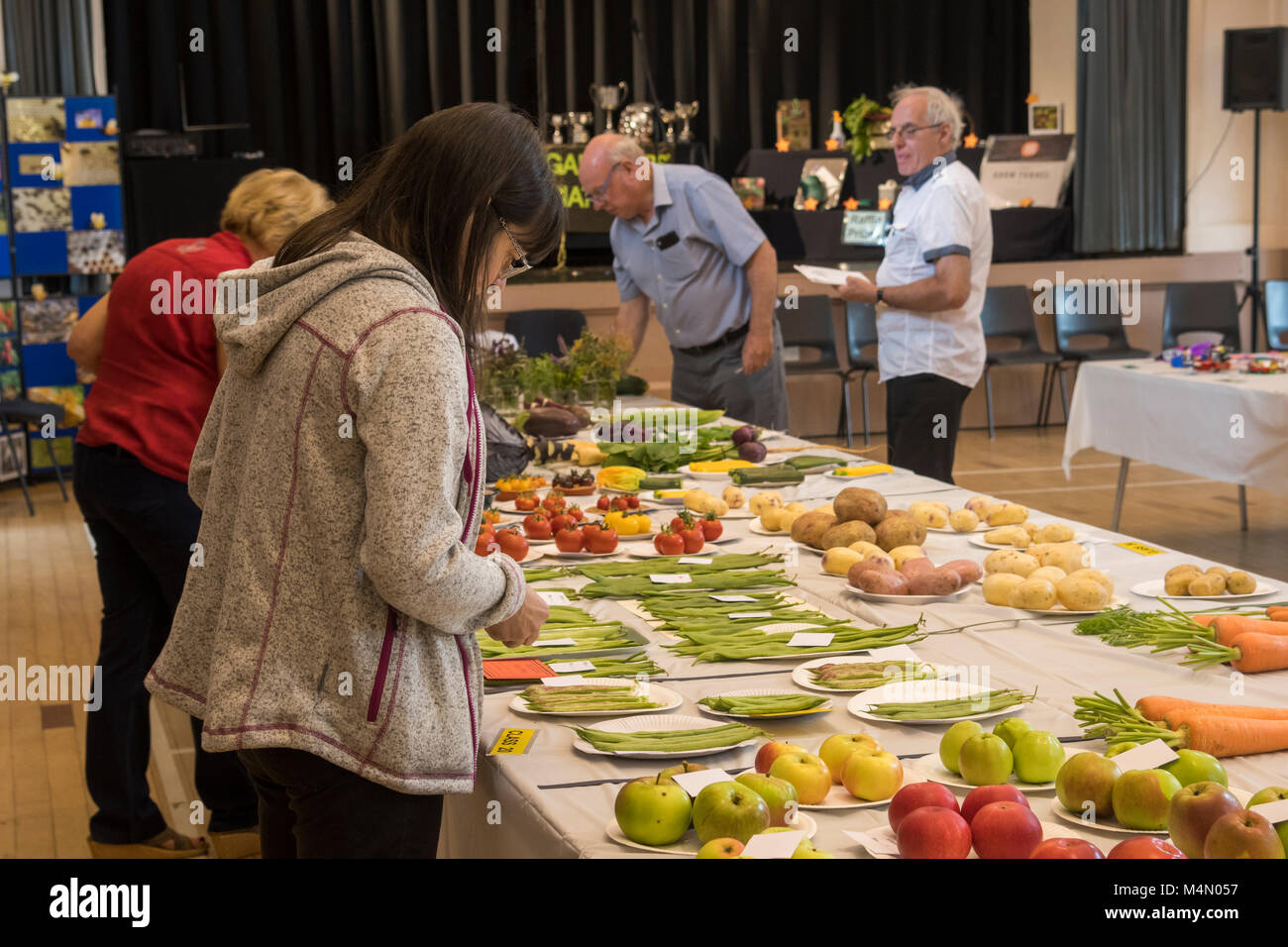 Judges & organisers with variety of fresh fruit & veg displayed in competition at Gardeners' Show - Burley-in-Wharfedale, Stock Photo