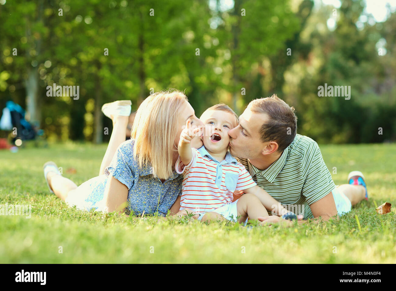 Portrait of a happy family in the park.  Stock Photo