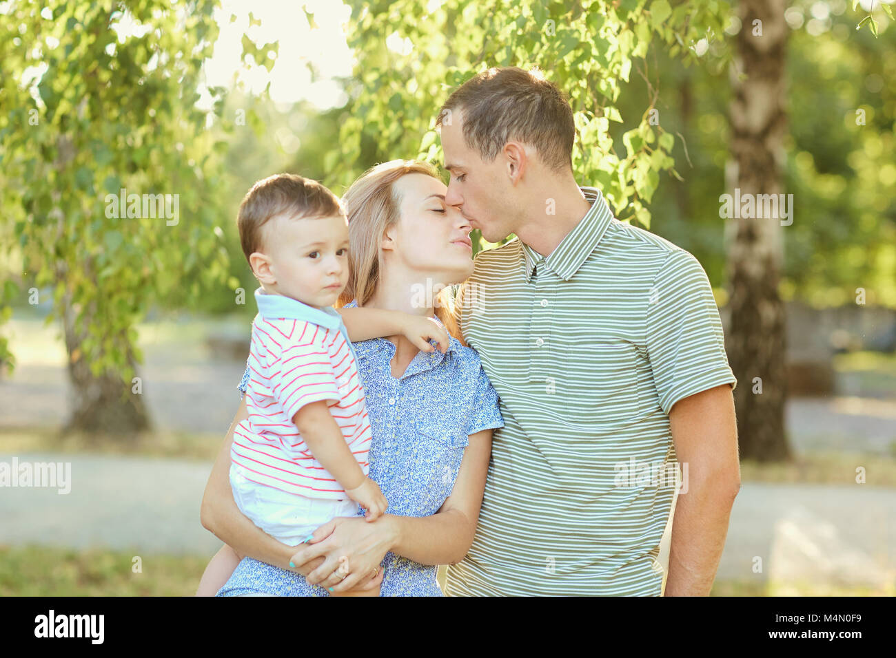 Portrait of a happy family in the park.  - Stock Image
