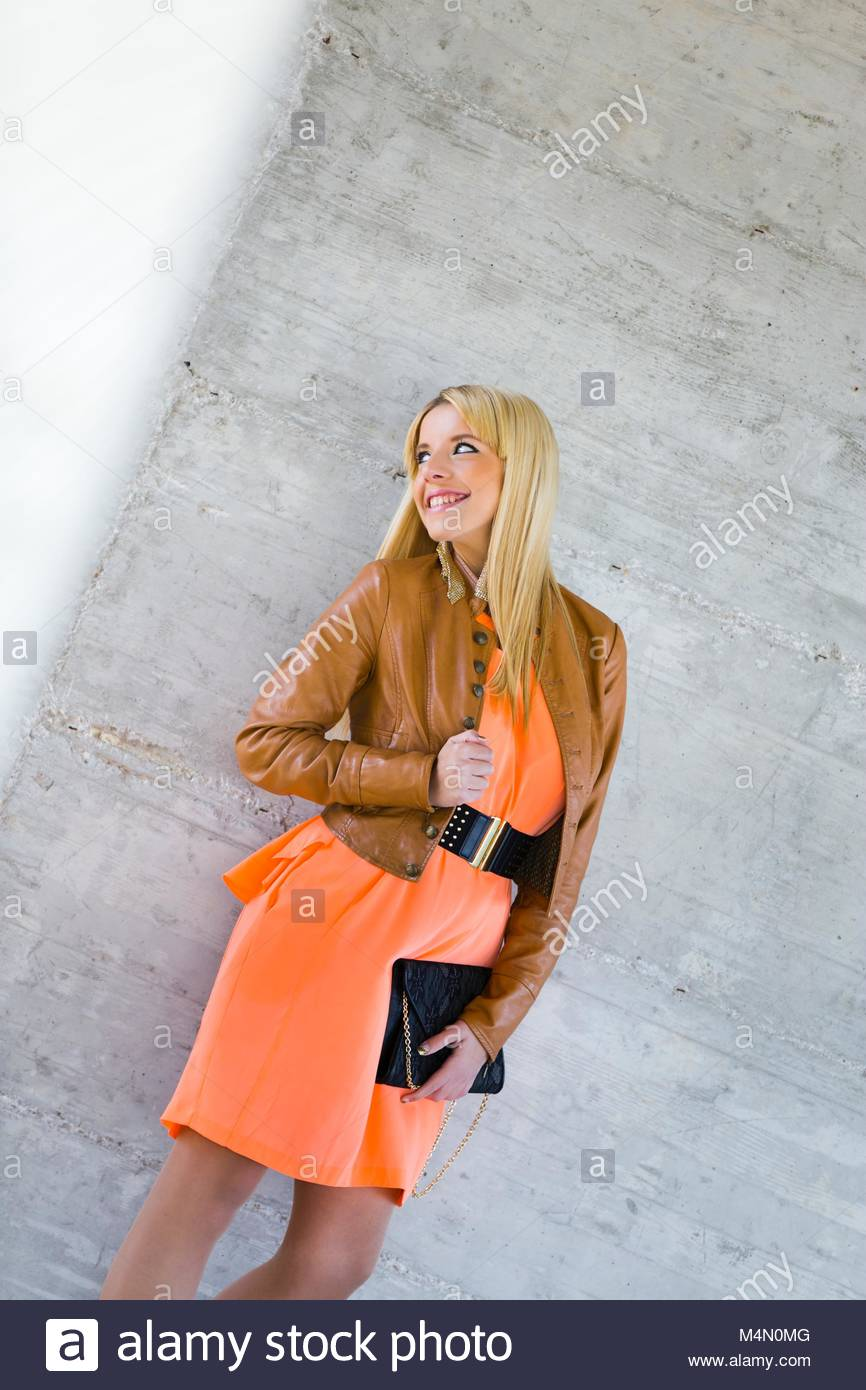 Pretty young woman is smiling away aside happy smile giggling giggle Stock Photo