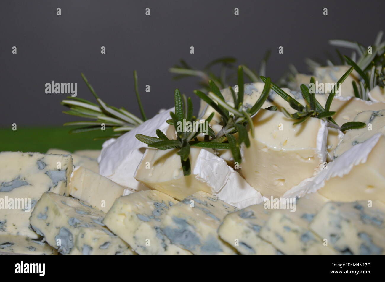 Zoom on some cheese decorated with rosemary Stock Photo