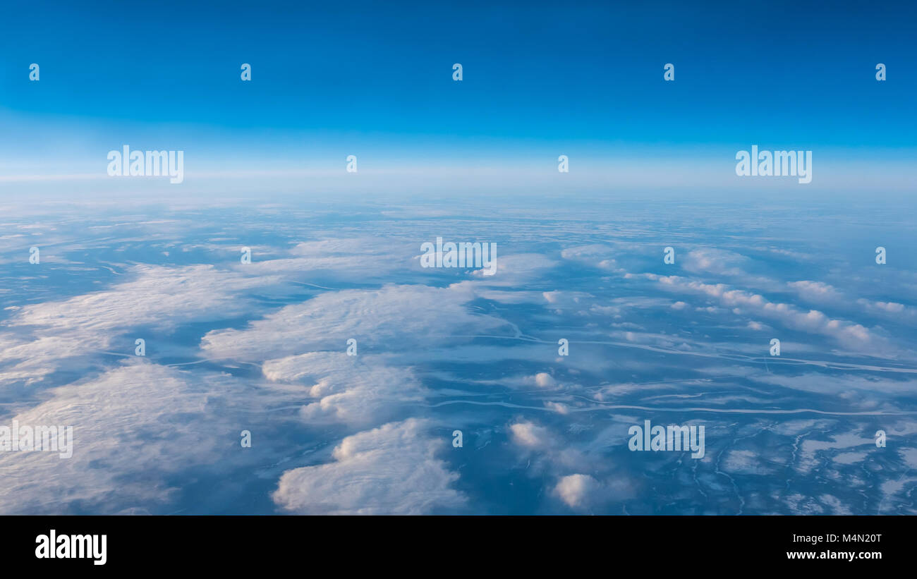 High Altitude View of Long River Streams in the Ground From Airplane - Stock Image