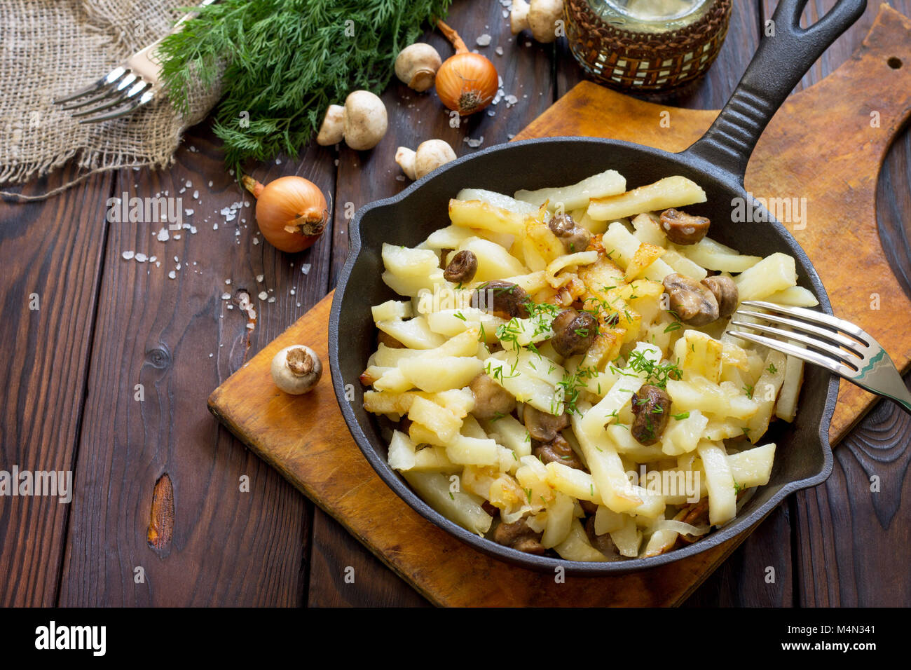 Fried Potatoes With Champignons Mushrooms On The Rustic