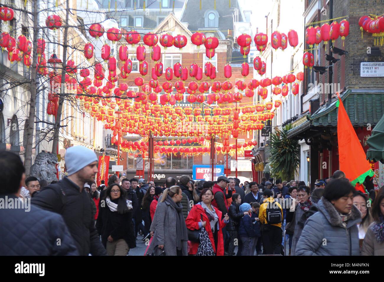 London, UK. 17th Feb, 2018. Londoners seen walking below Chinese lanterns in China Town London on 17 February 2018 - Stock Image
