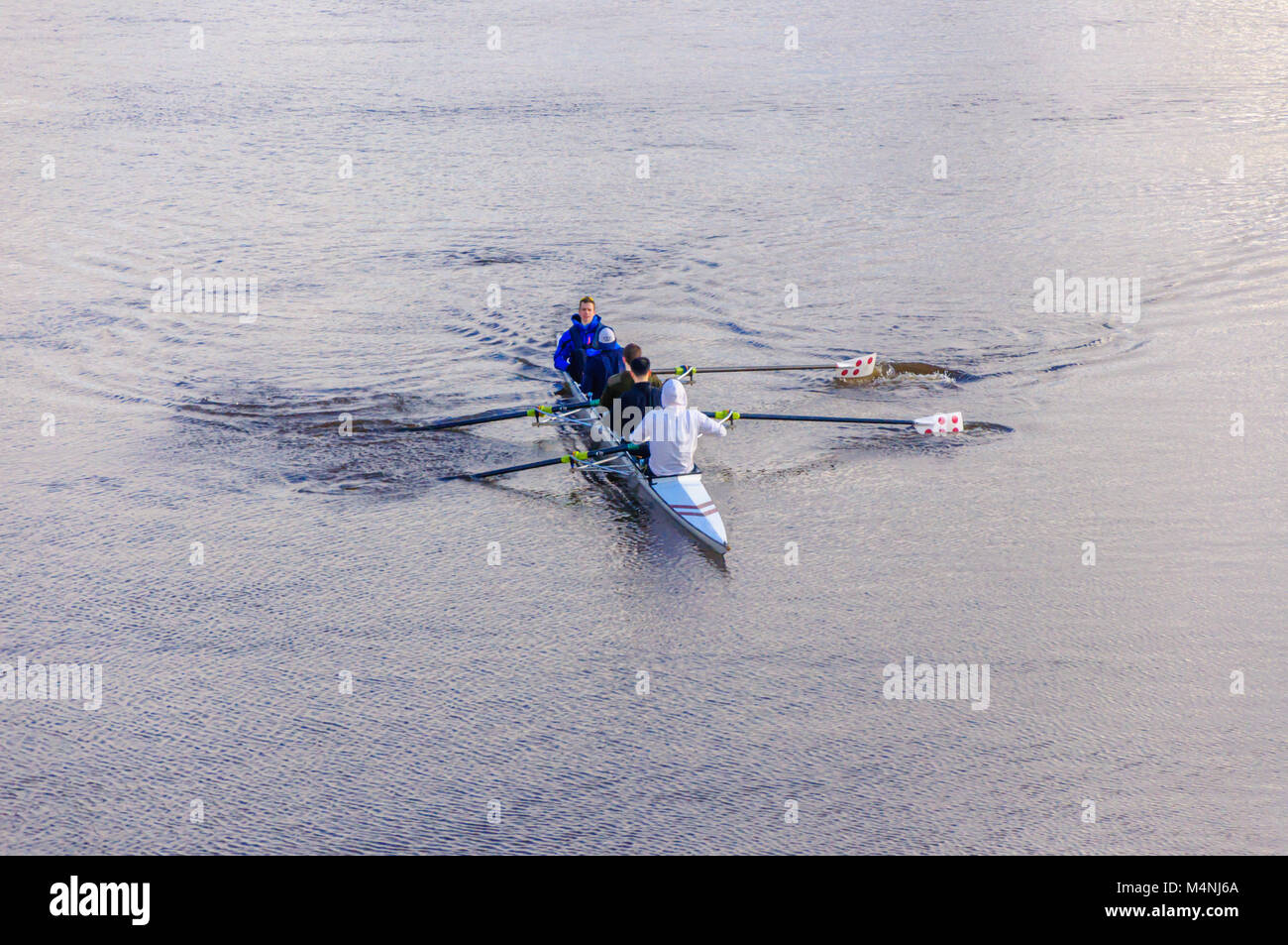 Glasgow, Scotland, UK. 17th February, 2018. UK Weather. Male rowers and cox in a coxed four rowing boat training - Stock Image