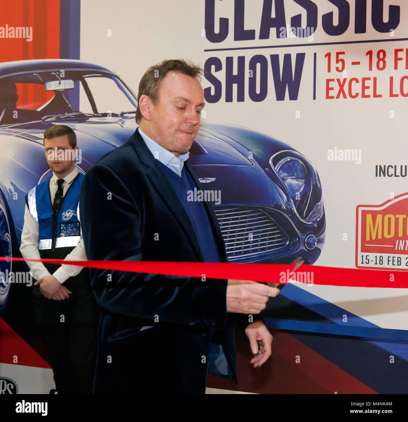 """London, UK. 17th Feb, 2018. Actor, Philip Glenister cutting a ribbon to open  """"The London Classic Car Show"""",   on Stock Photo"""