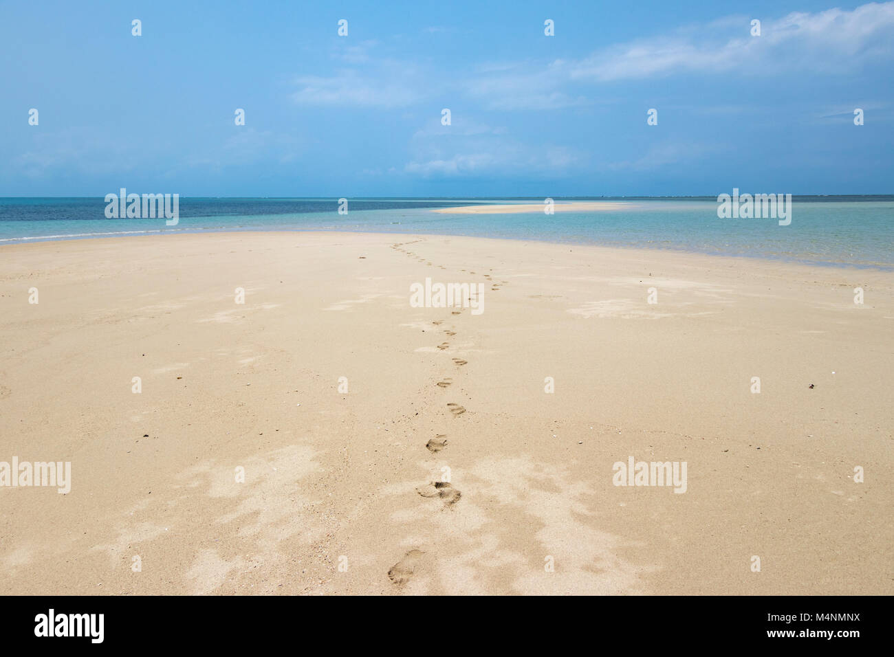 Desert island in Mozambique with turquoise sea - Stock Image