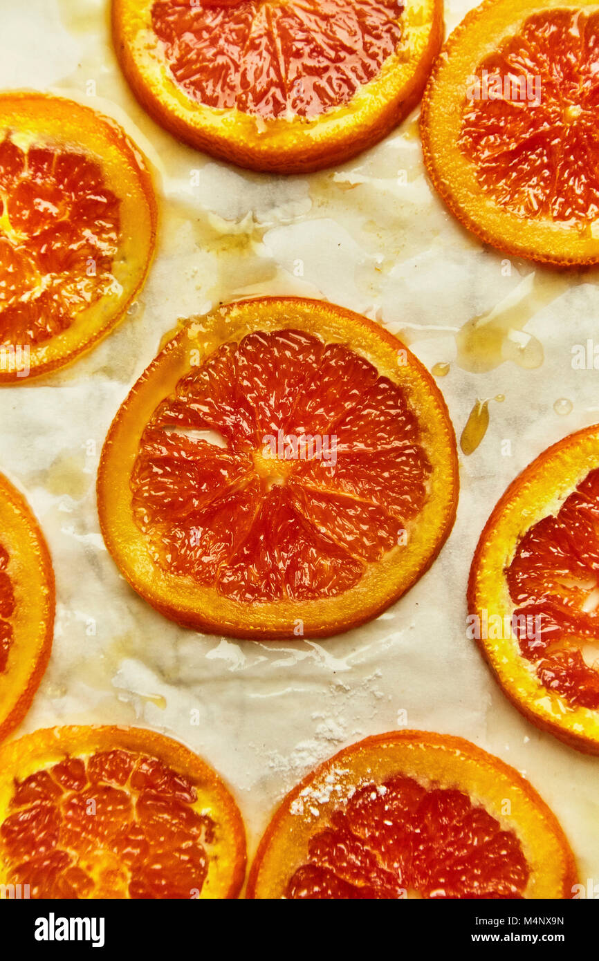 Caramelized slices of red orange used as a sweet snack or pie Stock ...