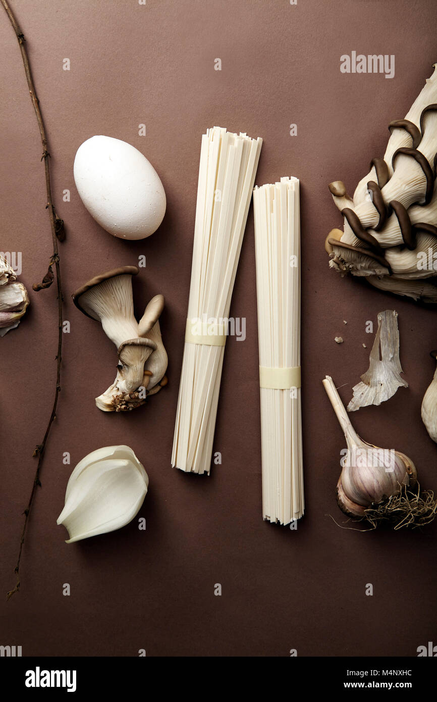 Asian cuisine ingredients on brown background. Monochromatic concept - Stock Image