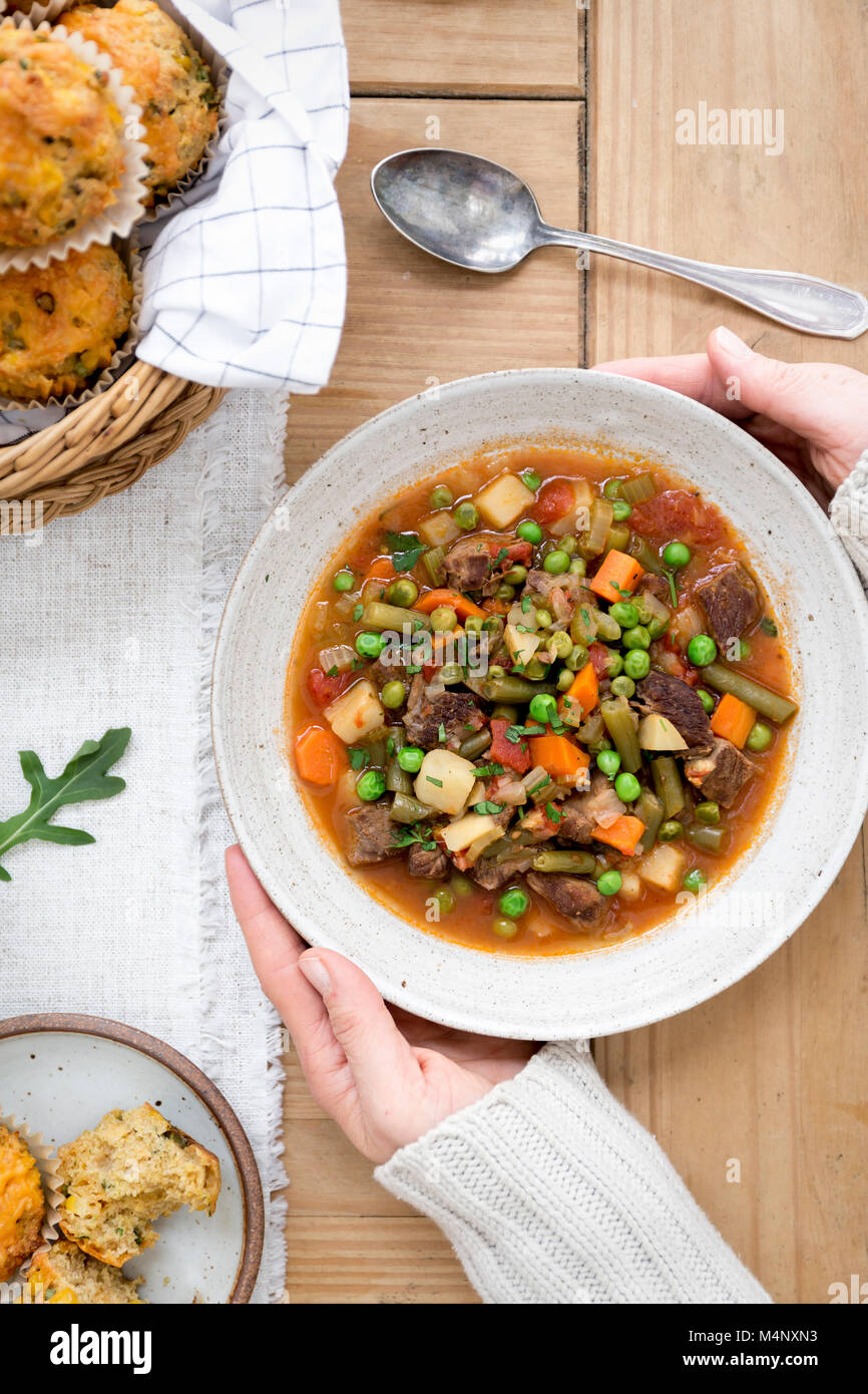 Vegetable beef soup with a person - Stock Image