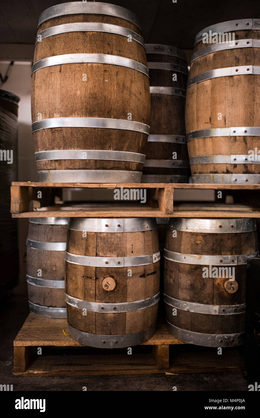 Pallets of beautiful, rustic, wine barrels in multiple sizes. - Stock Image