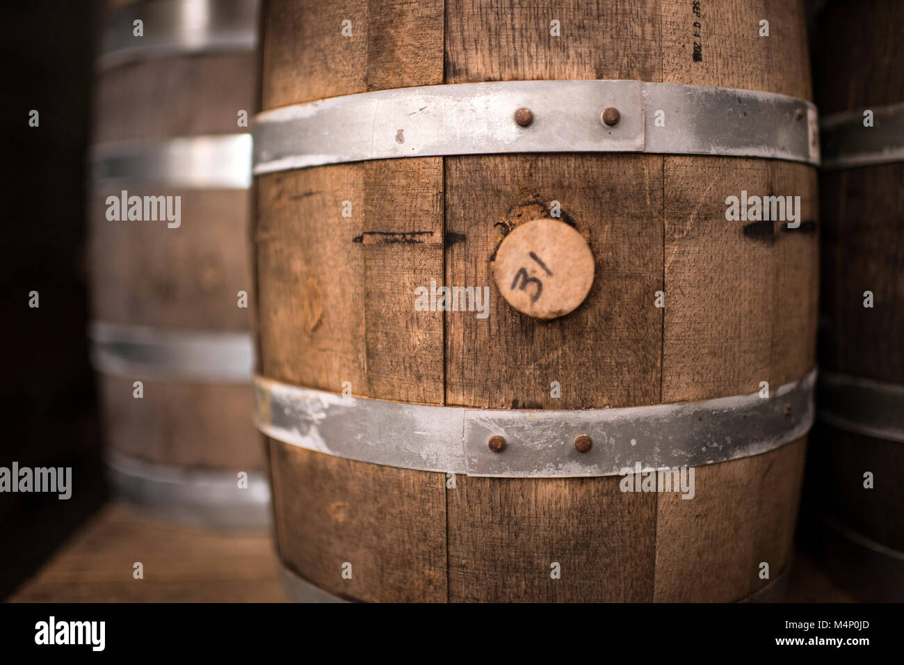 Detail macro shot of a rustic wine barrel. - Stock Image