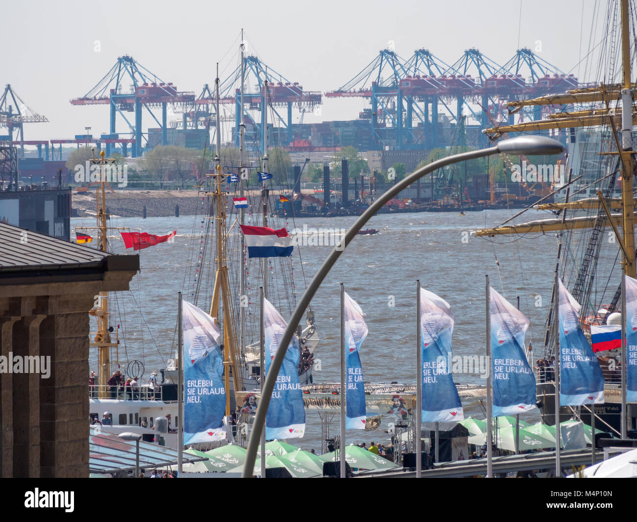 Hamburg, Germany - May 07, 2016: During the harbour's birthday , there are a lot of decorative waving flags - Stock Image