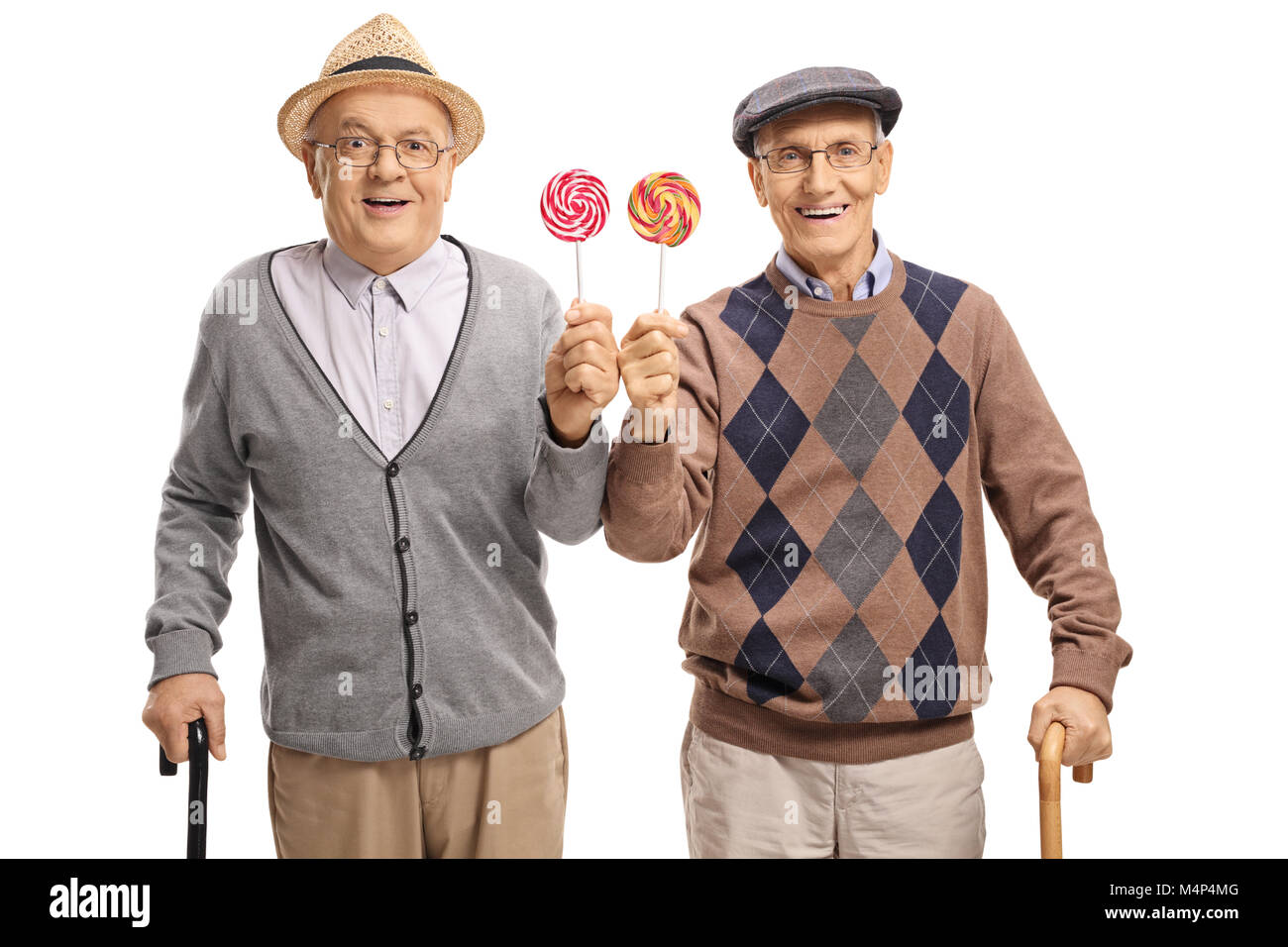 Seniors with lollipops isolated on white background - Stock Image
