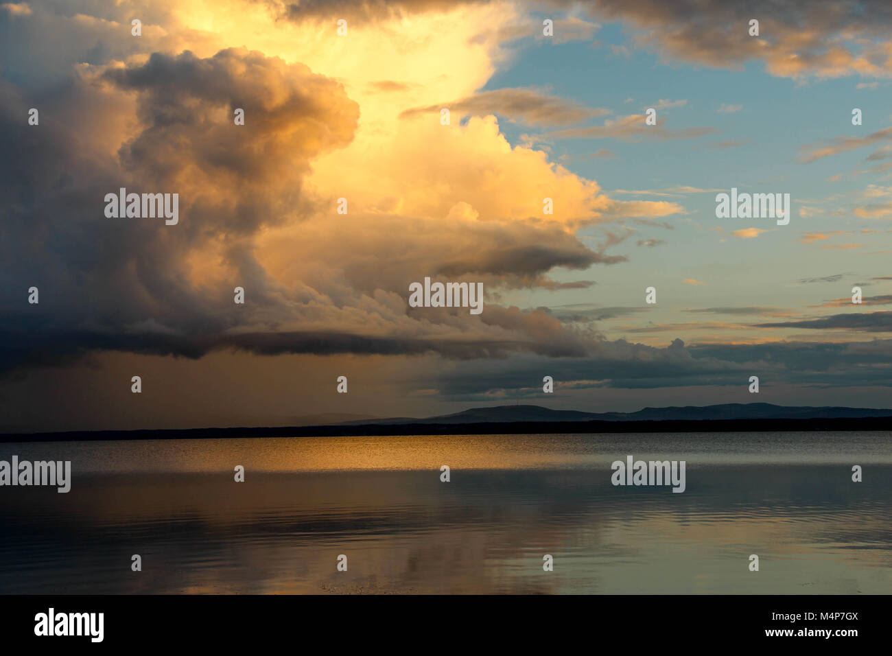 Sunset with colorful clouds over Orsa lake, Orsa, Dalarna, Sweden. - Stock Image
